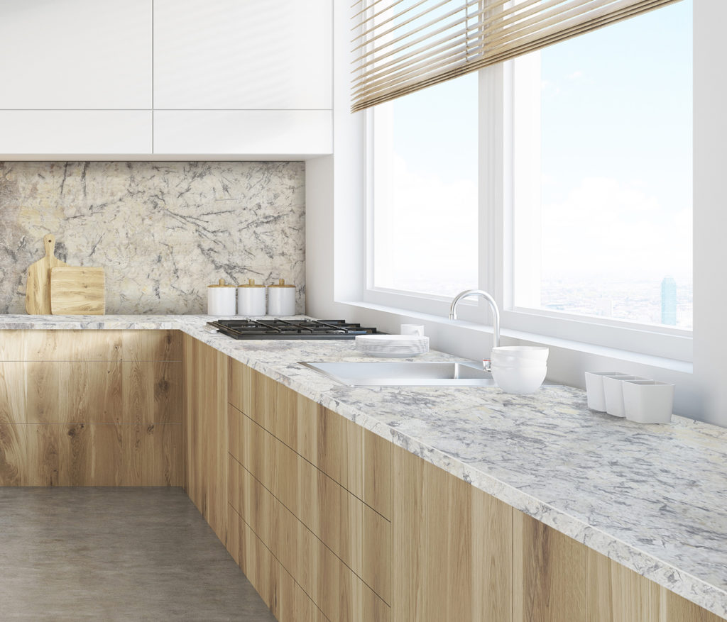Artic Cream Granite worktops with light wood cabinets