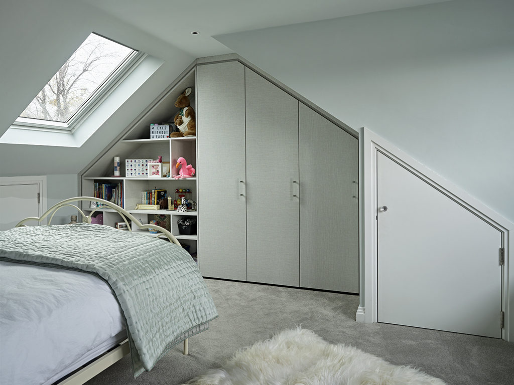 Loft conversion bedroom with fitted wardrobes by Brayer Design