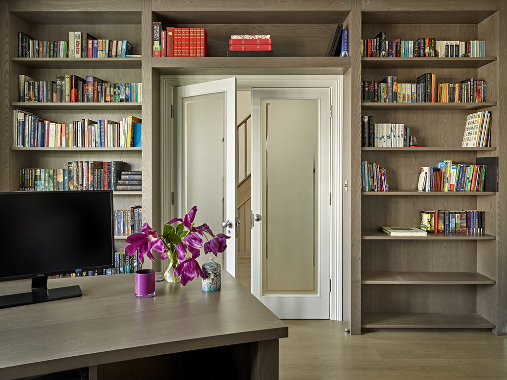 Study space and home office for home in wimbledon with built in bookcase and matching desk.
