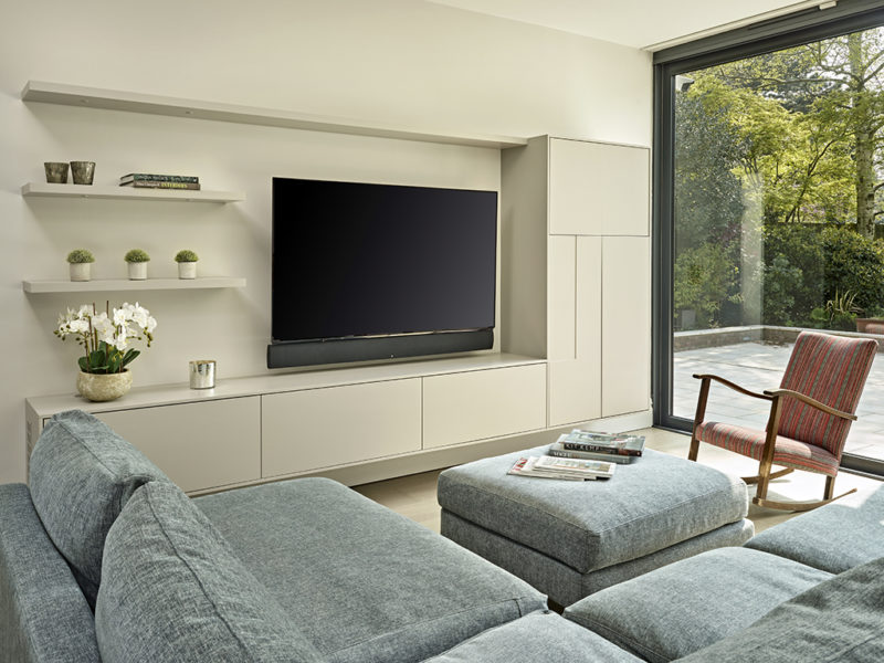 Modern living room with minimalist av display cabinet and floating shelves.