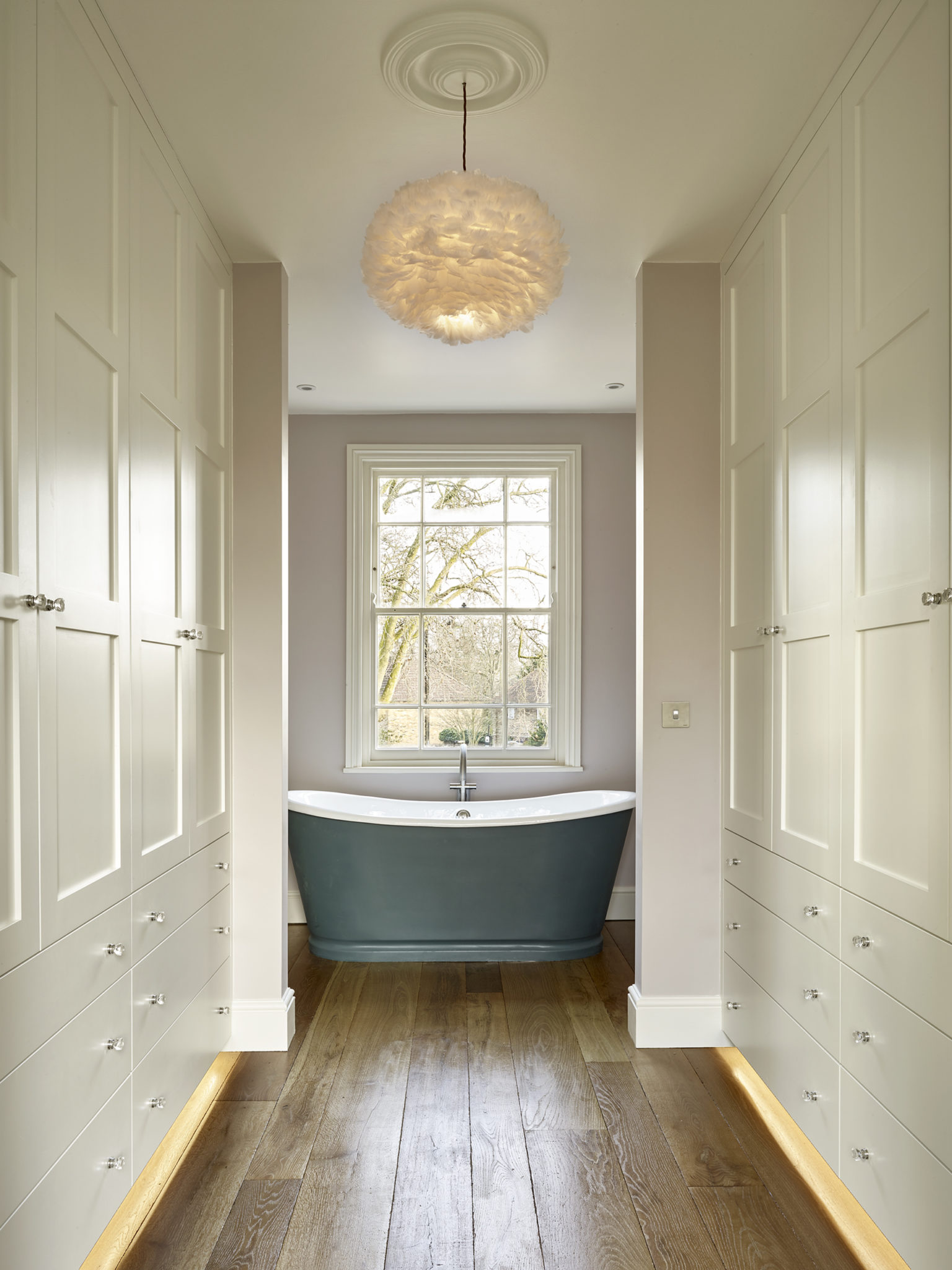 Ensuite dressing area with bespoke fitted wardrobes for London home