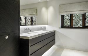 Dark wood vanity with double sink - bespoke made his and hers vanity unit