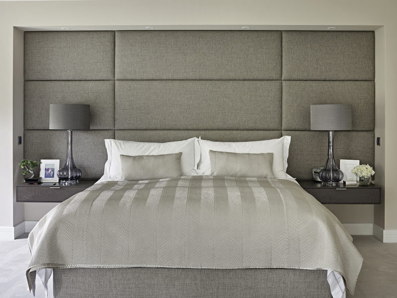 Luxury Master Bedroom design featuring upholstered headboard and floating bedside tables.