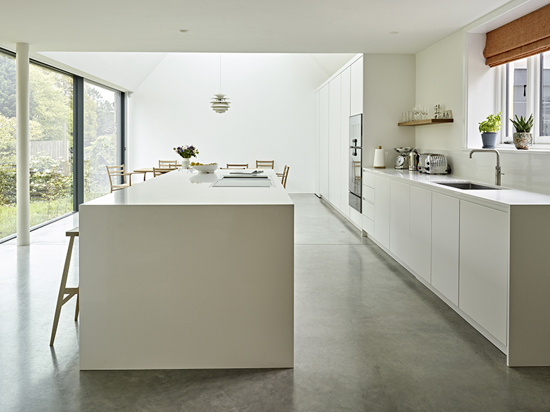 Scandi Style kitchen with large island, dining area and glass wall looking out into the garden