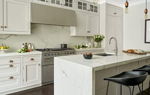 Shaker style kitchen in french grey by Little Greene with Statuario grey marble countertops and waterfall island