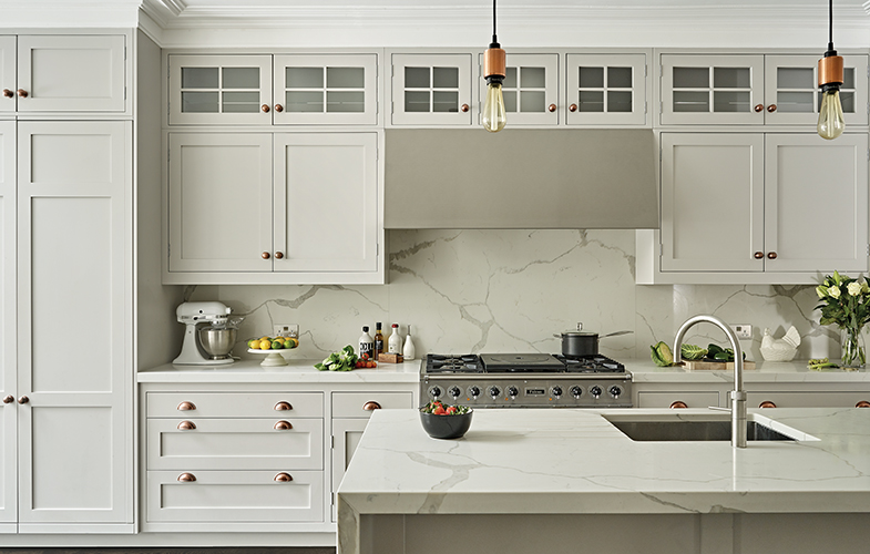 French grey shaker kitchen design with Statuario grey composite marble worktops and copper hardware