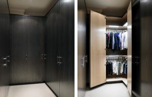 Luxury Dressing Room - Floor to ceiling custom-fitted wardrobes in dark wood exterior and light wood interior. With automatic lighting sensors inside.