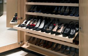 Bespoke wardrobe design interior with pull-out shoe storage racks
