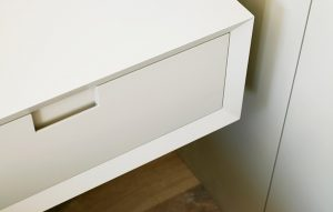 Minimalist white bedside tables. Futuristic design and part of complete bespoke bedroom furniture scheme