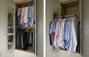 Fitted wardrobe interior with mirrors and electric fold down rail