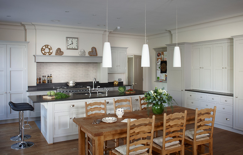 Esher traditional country kitchen design with shaker style cabinets, large island and range cooker with chimney extractor