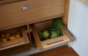 Esher country pantry cupboard interior in oak with sliding veg drawers