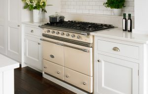 Cream range cooker with metro tile splashback and classic shaker cabinets either side