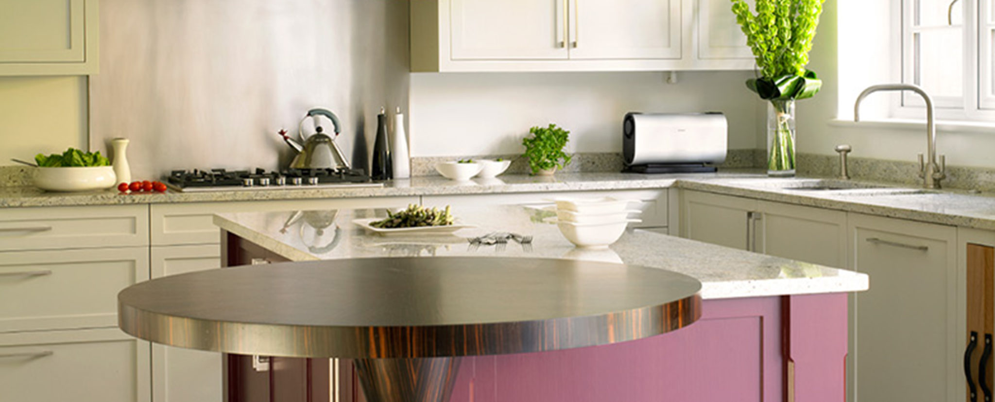 Modern shaker style kitchen with plum red island