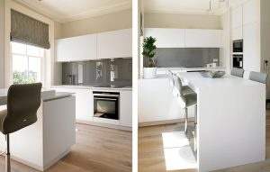 White matt lacquer minimalist and modern design for Kensington Kitchen with grey glass splashback and breakfast bar island