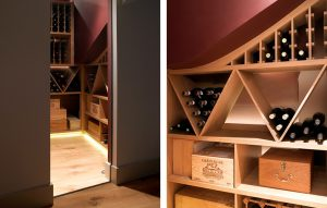 Bespoke built in wine storage in light wood finish, deep red walls and under cabinet lighting