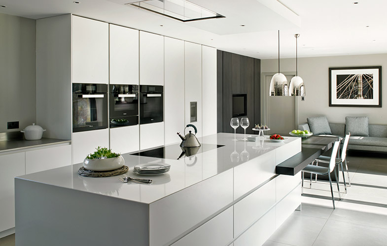 Cornforth White Wimbledon Kitchen Design with handleless cabinets and two tier island for preparation and dining
