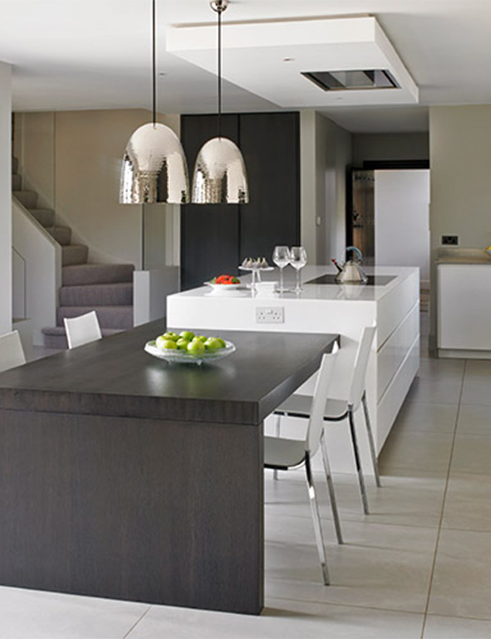 Modern Wimbledon Kitchen with secret door leading to a gym
