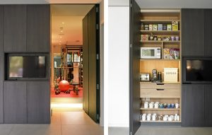 Wimbledon kitchen - secret door and tv cabinet leading into gym and open breakfast cupboard