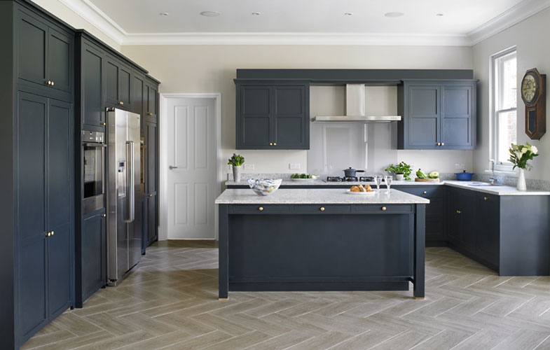 Blue Shaker Kitchen Design - Traditional kitchen with chevron floor.