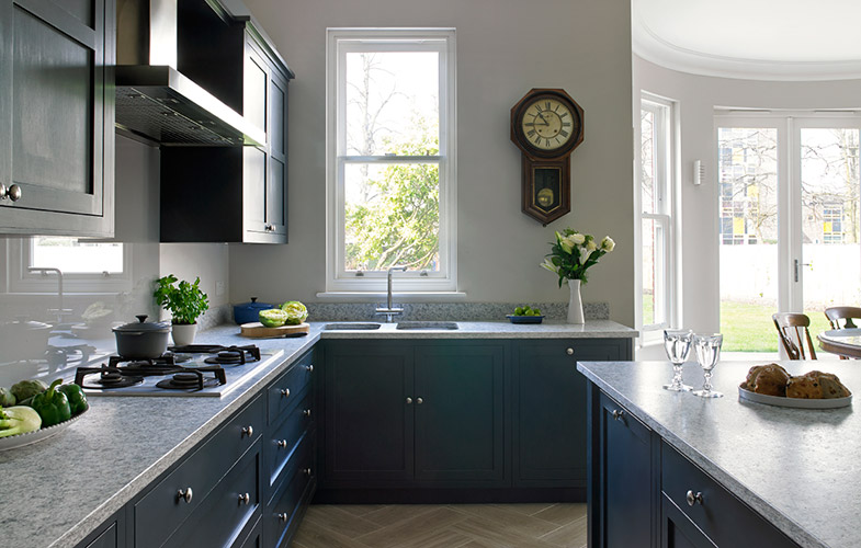 Esher dark blue navy kitchen with traditional shaker style cabinets and herringbone floor