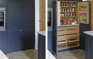 Pantry cupboard for Esher Kitchen design. Dark blue black exterior with light oak interior. Exterior finish - Railings by Farrow & Ball