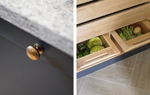 Esher kitchen close-up of dark blue cupboard doors and pantry interior in light oak with vegetable drawers