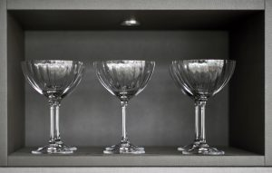 Wandsworth riverside apartment media wall/display cabinet close up, champagne glasses on display