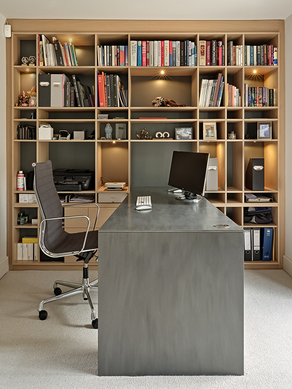 Home office with built in bookcase and desk by Brayer Design