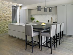 Grey Wandsworth Bespoke fitted kitchen. Featuring minimalist kitchen island with elevated breakfast bar and bespoke-made stool seating.