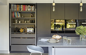 Minimalist kitchen pantry and breakfast cupboard design with retractable doors. Satin matt lacquered in 'Inky Blue'