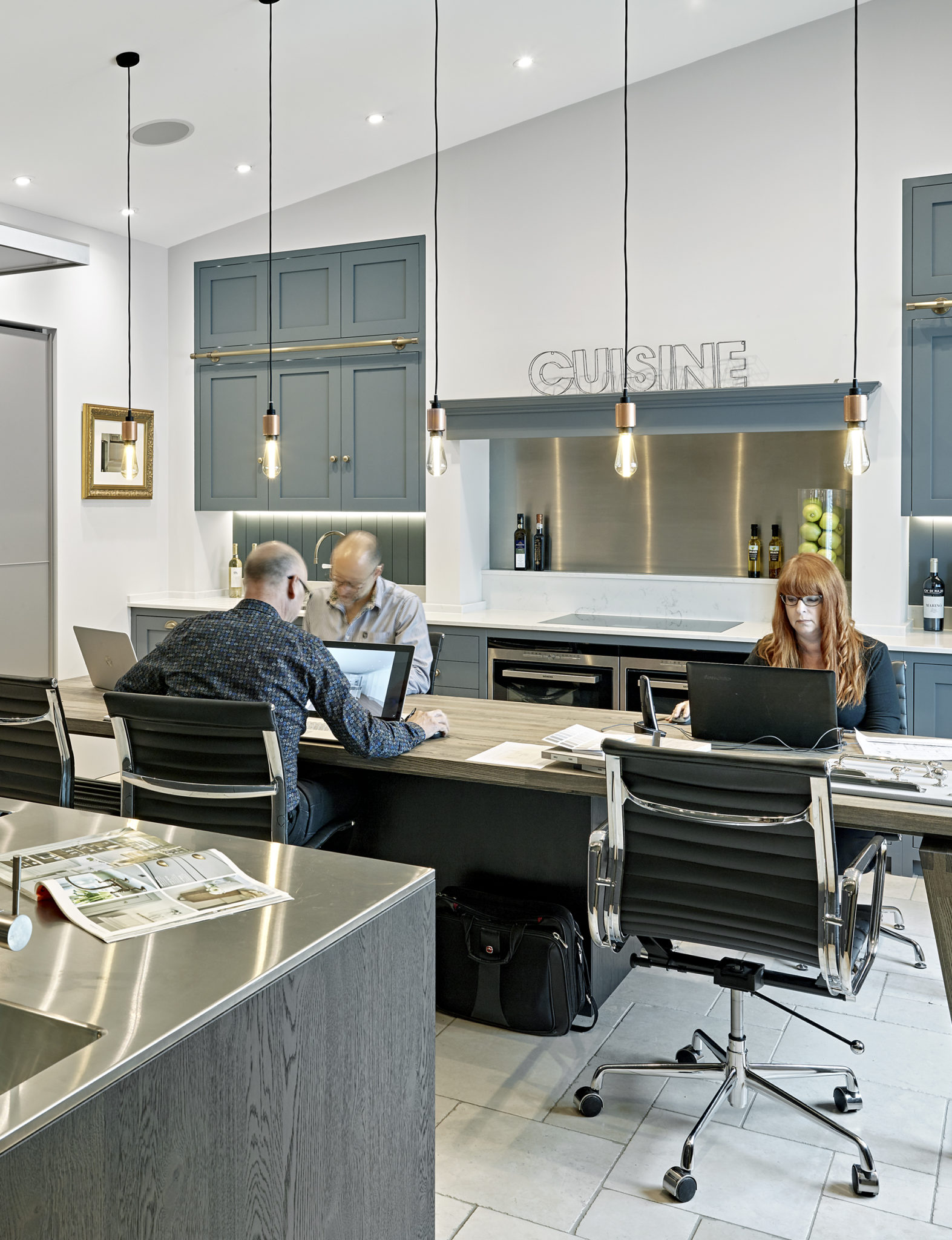 Busy working in the design office/studio, upstairs at Brayer Design - Our Services
