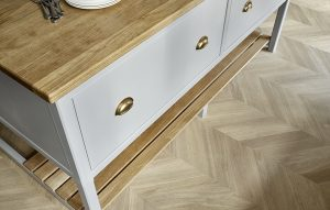 Island drawers painted in Little Greene mid lead with burnished brass cup handles, oak worktop and parquet floor.