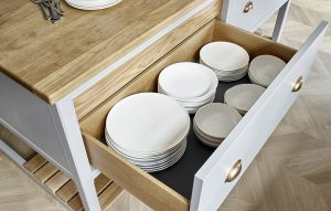 Grey island drawer plate storage with oak interior and antique brass cup handles