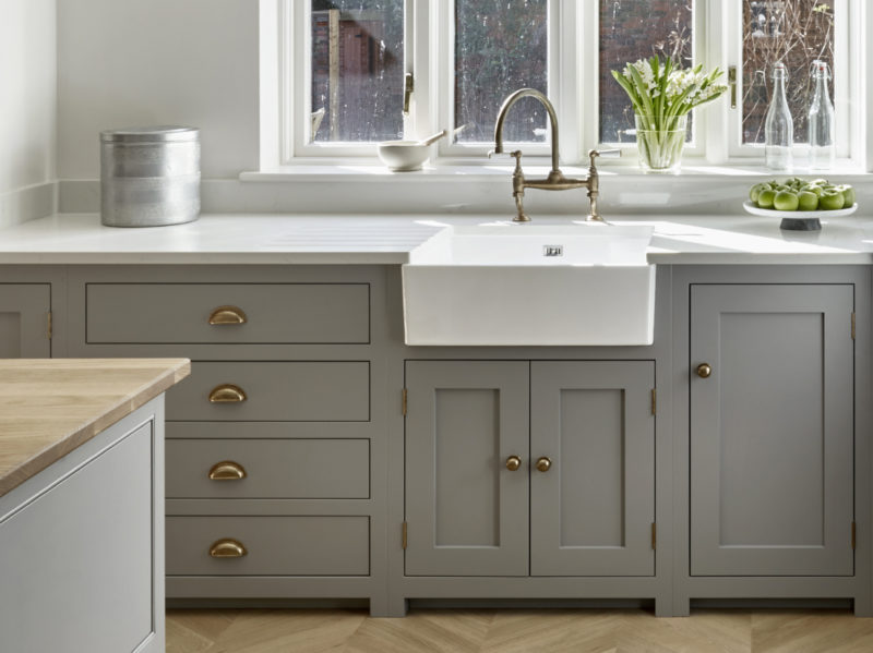 Grey shaker kitchen with traditional handles and butler sink
