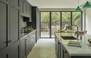 Dark grey black cabinets and light grey Calacatta marble-effect surfaces - Battersea Kitchens