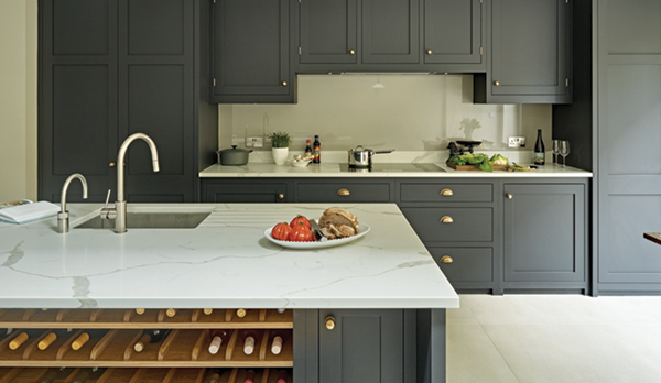 Charcoal Grey Black Dark Kitchen Design in shaker style with burnished brass handles with kitchen island with a wine rack and grey Calacatta marble-effect worktops