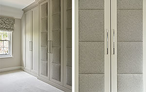 Grey fitted full length wardrobes with upholstered doors and long thin handles