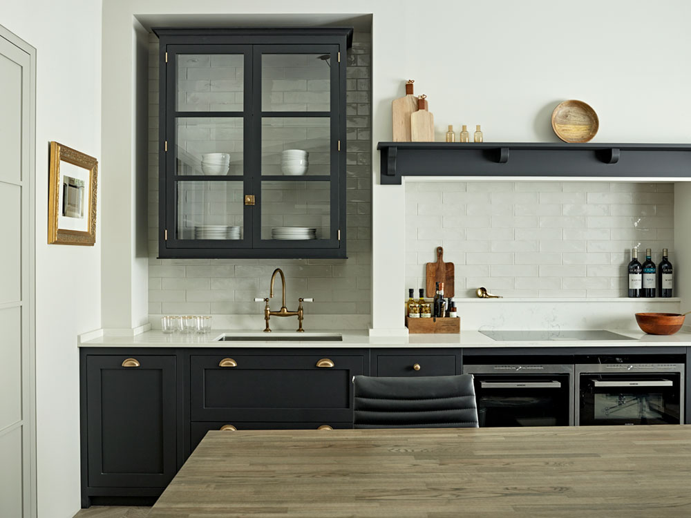 Brayer Design display kitchen with country shaker dark kitchen cabinets, white worktops and traditional brass hardware