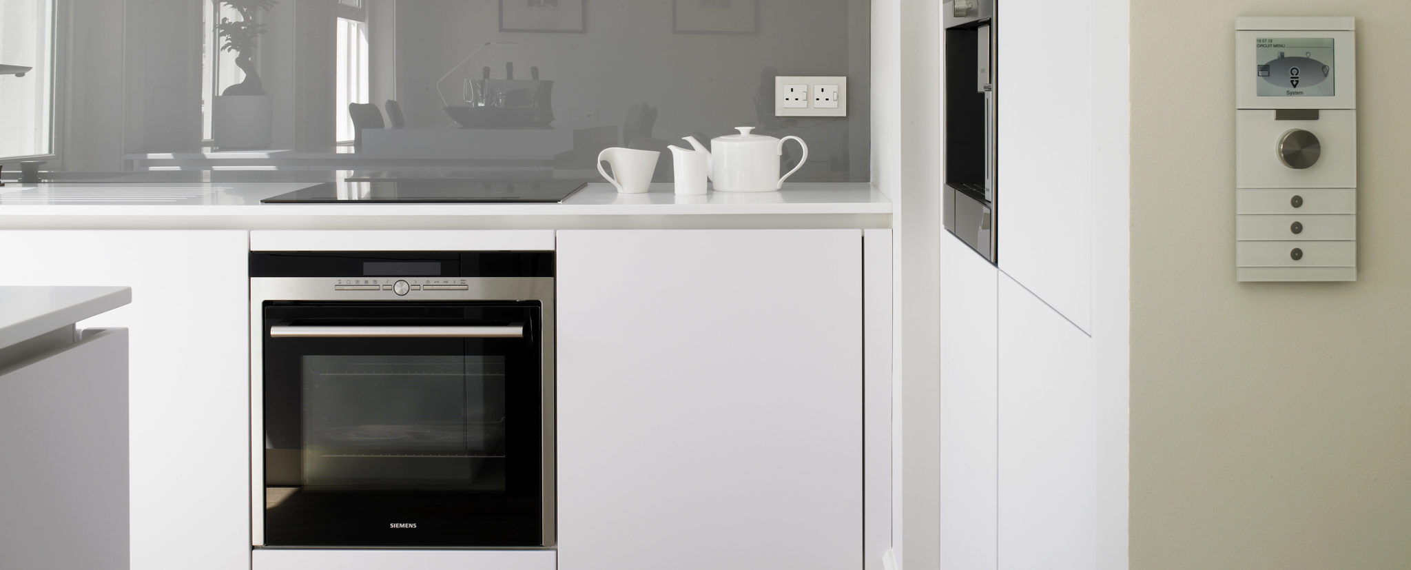 Compact white kitchen design Kensington apartment.