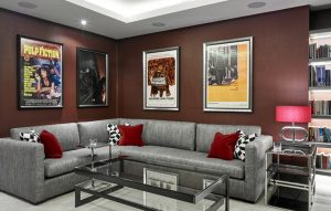 Red and grey modern cinema room design with bespoke made furniture
