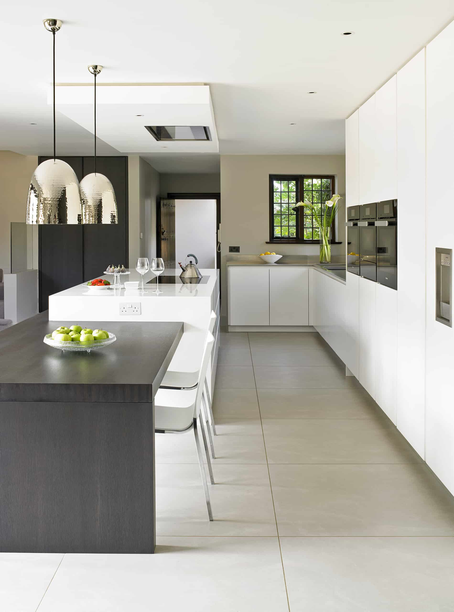 Wimbledon Modern White Kitchen with adjoined island dining table