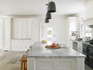 Felsted large white shaker style kitchen island with Super White Quartzite worktop.