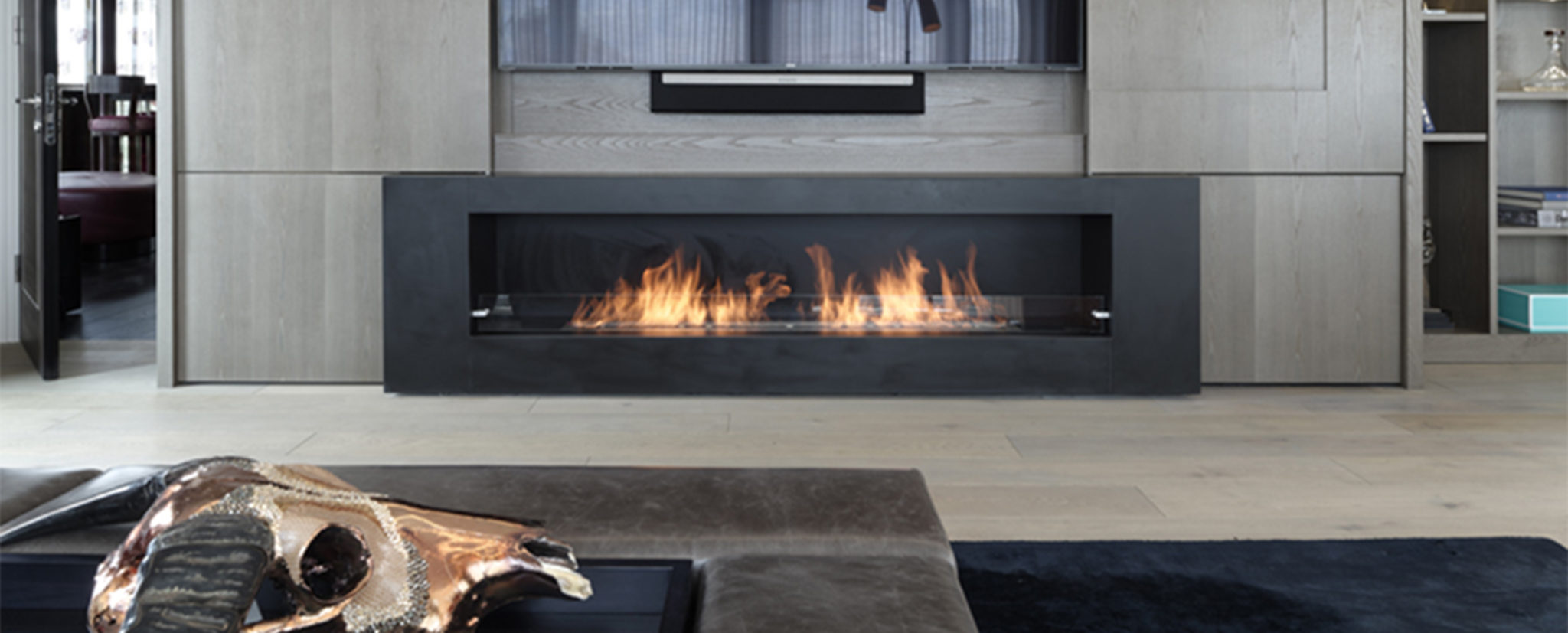 Contemporary built-in media wall and tv cabinet above fireplace for Chelsea Penthouse renovation