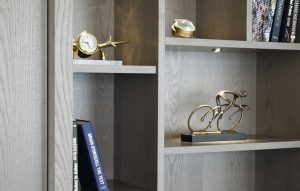 Lit display cabinet close-up for Chelsea apartment renovation