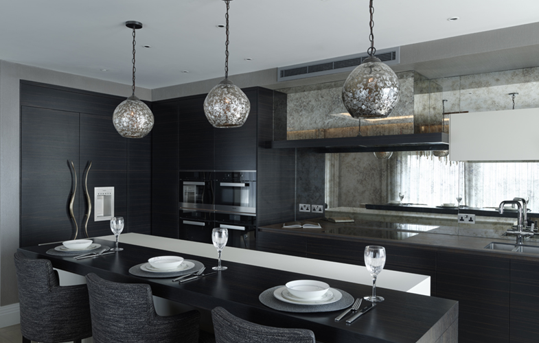Modern Chelsea kitchen - breakfast bar, handleless cabinets in luxury dark-wood finish and mirror splashback