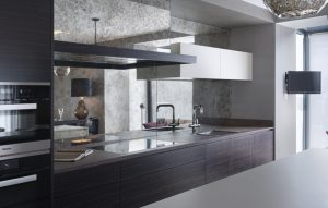 Chelsea Kitchen Design - dark wood handleless cabinets with mirror splashback