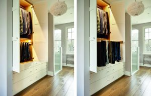 White fitted wardrobes for ensuite dressing room, with automatic lighting and pull-out trouser rack