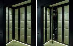 Dark wood and padded upholstered wardrobes with floor lighting for luxury bedroom design.
