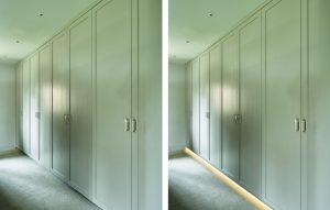 Modern floor to ceiling fitted wardrobes. Minimalist design with under wardrobe ambient floor lighting.